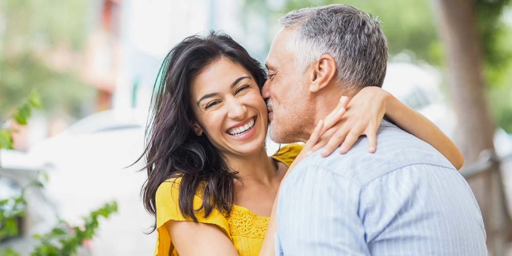 Couple Kissing with Big Beautiful Cosmetic Smile